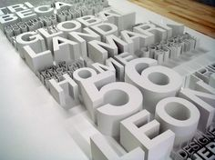 Sculpture with letters and numbers - white on white by Tietz-Baccon. could be a fun way to add a name to a kids room, front entry of home or office building.