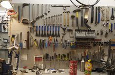 Blurry picture of a bicycle tool board. Cluttered, but maybe some ideas here. #bicycletoolboard