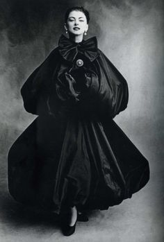 Irving Penn For Balenciaga. An oversize coat in satin creates a feminine silhouette.