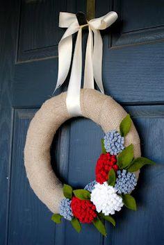 burlap and felt flower wreath on a straw circle