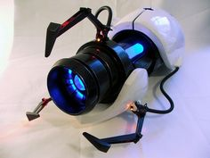 A Portal gun created by prop maker Harrison Krix, which sold for $14000 at a Childs Play auction. volpinprops.com
