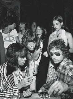 Keith Richards, Mick Jagger, and Bob Dylan at Jaggers 29th birthday party, July 1973. Photo by Ken Regan.