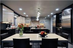 I love high contrast when it's done well. Notice all the light sources.  You need lots and lots of lumens in a dark kitchen. Elegant contemporary kitchen by Donald Hochheiser, CR of Kitchen Designs by Ken Kelly.