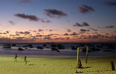 Children play soccer with their father at Mucuripe beach in Fortaleza, Brazil, Sunday, June 16, 2013. Fortaleza is a host city of the Confederations Cup match between Brazil and Mexico next Wednesday, June 19. (AP Photo/Andre Penner)