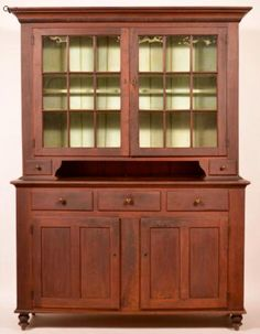 """Conestoga Auctions   Jan. 30, 2016.  Lot: 649.       Estimate:$8,000 – $12,000.  Sold: $10,285.      Description: Lancaster County, Pennsylvania Federal Walnut and Burl Walnut Two Part Dutch Cupboard. Signed on back board """"H K Shirk Ephrata Pa"""". Cove molded cornice with spool turned trim, two nine pane glazed upper doors, open pie shelf flanked by dovetailed lip molded candle drawers. Lower section with cove molding, three split lip molded dovetailed drawers and two lower double sunken…"""