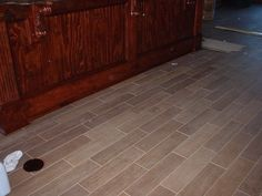 Ceramic tile flooring with the look of wood.
