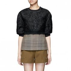 --evaChic--This 3.1 Phillip Lim Floral Cloqué Houndstooth Hem Puff Sleeve Top from FW16 is a cool combo of heritage and modern materials in an unexpected silhouette that includes different volumes and paneling. It looks like a shiny textured short-sleeve sweatshirt layered over a fitted wool top, yet in fact it is one fashion-forward piece.       http://www.evachic.com/product/3-1-phillip-lim-floral-cloque-houndstooth-hem-puff-sleeve-top/