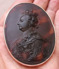 """Queen Anne of England ca. 1705         Material: Tortoise shell, 15 k rose gold tested. Size: 2 6/8"""" by 2 3/32"""". Date and Origin: 1705 marked, Eng..."""