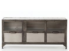 Inspired by an industry foundry, the Element TV console features a dark iron frame that contrasts with with antiqued nickel panels. Construction marks add to the character of the piece and offers an intriguing design element.