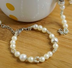 A personal favorite from my Etsy shop https://www.etsy.com/listing/278146132/classic-pearl-bracelet