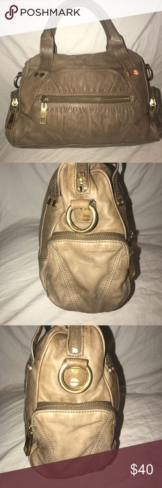 Steve Madden Taupe Leather Satchel Purse Cute taupe leather Speedy Handbag. It has a main zip pocket with a wall zip pocket and two wall slip pockets. It has a zip pocket up front and small zip pockets on the sides. It has brass hardware. It does not have a longer shoulder strap. It shows Wear from use. It measures about 12.5 inches in length, 9 inches in height, 4 inches deep at the bottom, and the strap drop is about 6 inches. Steven By Steve Madden Bags Satchels