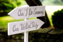 "These are really cute signs. Our ""I Do"" Ceremony and Our ""We Did"" Party signs in white with silver lettering."