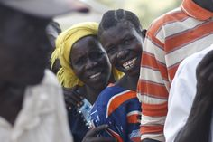 People in a remote area of South Sudan start lining up to get their vaccinations. Photo by The Times/Richard Pohle