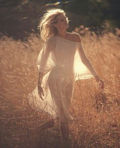 A BREATHTAKINGLY BEAUTIFUL, photo of a walk through the fields enjoying the breeze not a care in the world