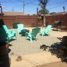 Backyard project 2016!   Here's the final product and the fruit of our labor. We chose to decorate our new fire pit area with Tiffany blue adirondack chairs. We built our Cali Light Posts by cutting wine barrels in half, adding 4 galvanized steel angles, a bit of concrete to stabilize the pressure treated post, then filled with soil and a few Angelina flowers. We added hanging pink Petunia planters to add to the color scheme.