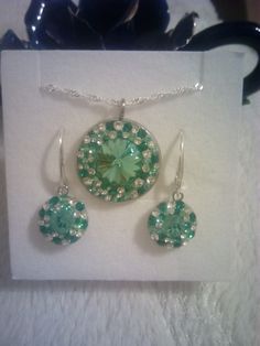 Light turquoise Swarovski crystals earrings in Ceralun construction.