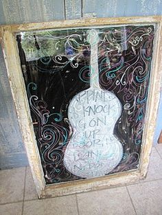 guitar, song lyrics on old window