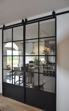 Loving these glass barn doors! #Inspiration #Kitchen #Barndoors #Greenbasementsandremodeling #AtlantaConstruction #roswellremodel