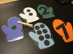 Mitten game - students count dots, match to numbers, and place clothespins on dots.