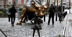 A Statue of a Defiant Girl Now Confronts the Famous 'Charging Bull' on Wall St.  A young girl stares down the famous Wall Street charging bull on International Women's Day. A small bronze statue of a girl, designed by artist Kristen Visbel, appeared overnight in the path of the bull statue. It's intended to highlight the gender disparity of senior level roles at US financial firms; 85 per cent of financial advisors on Wall Street are men. #IWD #IWD2017 #WallStreet