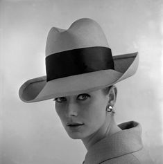 Tania Mallet in rimmed hat with sash, photo by John French