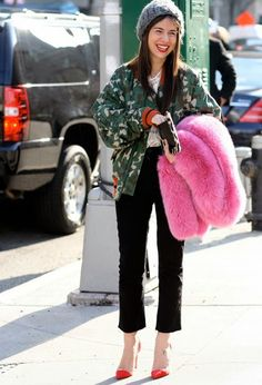 How great is the pink fur thrown over her arm???