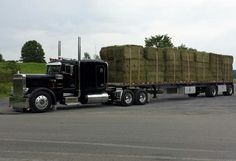 Peterbilt custom 359 loaded with hay