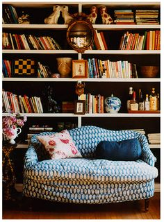 A personal library with a beautiful couch and a good supply of liquor.  I love it.
