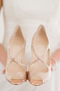 I honestly think I'll be in sandals or barefoot for my wedding, but these are just ...wow.  gold louboutins