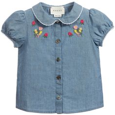 Baby girl's cute blouse by Gucci, made with a soft and a lightweight blue cotton chambray. It has a Peter Pan collar and a short cupped sleeves with white embroidered trim. The front fastens with petal-shaped buttons and the chest is embellished with pretty embroidered flowers.<br /> <ul> <li>100% cotton (soft, lightweight chambray feel)</li> <li>Machine wash (30*C)</li> <li>Button fastening</li> <li>Made in Italy</li> </ul>