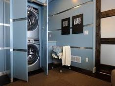 A laundry room in the basement creates a perfect place to iron, wash and dry your clothes or handle your hand-washables Tags: basement laundry room ideas, basement laundry room remodel, basement laundry room makeovers, basement laundry room cabinets Laundry Room Doors, Laundry Room Remodel, Laundry Room Cabinets, Basement Laundry, Laundry Room Organization, Laundry Room Design, Blue Cabinets, Diy Cabinets, Laundry Room Pictures