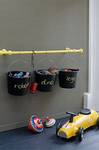 Hang buckets on a rod. | 49 Clever Storage Solutions For Living With Kids