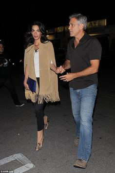Outside of work: Amal and George Clooney are pictured going out together for sushi in Holl...