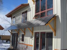 Solar panel awnings are very aesthetic and is a creative way to get more energy production out of your solar array if you don't have enough roof space.