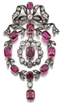Ruby and diamond brooch pendant, 1900. Of wreath and bow design, set with oval…