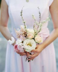 The flowers bridesmaids carry down the aisle may be a small-scale version of the bridal bouquet, but they can and should be just as beautiful! To help inspire your own bridesmaids' bouquets, we rounded up a few of our favorites from real weddings. Simple Wedding Bouquets, Bridesmaid Flowers, Bride Bouquets, Wedding Bridesmaids, Bride Flowers, Flower Girl Bouquet, Blush Bouquet, Flower Bouquet Wedding, Martha Stewart Weddings