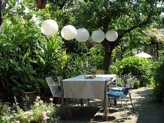 paper lanterns add a touch of whimsy to an intimate garden event.