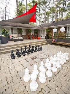 Outdoor Chess - Licensed contractor Chip Wade created an outdoor deck and patio that's fully equipped for warm-weather entertaining. This family-friendly space includes a fire pit, dining area, kitchen, outdoor chess and places to play basketball and volleyball.