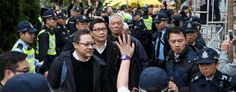 Occupy Central civil disobedience founders Benny Tai Yiu-ting, Chan Kin-man and the Rev. Chu Yiu-ming walk to police station in Hong Kong. (Tyrone Siu/Reuters)