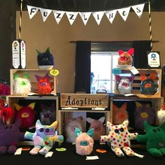 All set up and ready for the adoptions to begin   Fuzzlings and Beevils and Snippets are colourful  plush monsters just waiting for hugs!