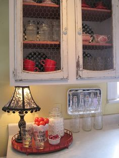 chicken wire, distressed cabinets.....I KEEP LOVING IT MORE!!