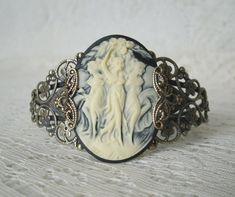 This beautiful antique brass filigree cuff bracelet has antique brass filigree accents and a beautiful triple goddess cameo. Renaissance Jewelry, Edwardian Jewelry, Vintage Jewelry, Vintage Bracelet, Art Nouveau Jewelry, Jewelry Art, Weird Jewelry, Hand Jewelry, Jewelry Design