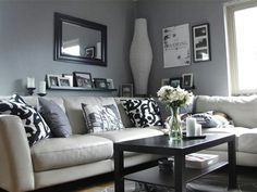 Living room decor.  Love the mirror with picture shelf below