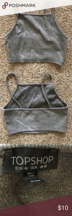 Topshop ribbed grey crop Worn once knitted crop top. Polyester blend. US size 8.  Moving sale! Everything has to go, bundle for better deals. Please help me reach my goal of having a minimalist closet by the end of the year. All items in my closet are gently used unless stated otherwise. I ship same day! Thank you and happy shopping. Topshop Tops Crop Tops