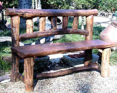 This well-constructed outdoor bench with wooden back makes for a great addition to any outdoor decor, including farms, gardens, and outdoor patios.