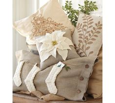 Love that there are 3 knit stockings... representative of all my kiddos. :)  Love the simplicity of all these pillows for the Christmas season.