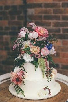 21. This years pantone colors come together flawlessly with this lovely cake fromLulu's Secret Sweets, and what cake would be complete without some incredibly realistic sugar flowers?