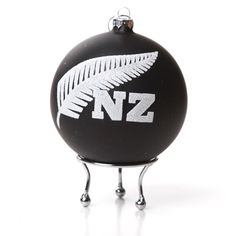 A great way to celebrate a truly Kiwi Christmas. These 10cm matt finished black baubles feature the New Zealand fern design in white glitter. Price includes calligraphy. Add a name, year and message to make a unique, personal and gorgeous Christmas gift. Chrome stand optional extra.
