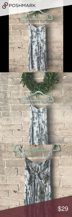 Urban outfitters sky blue and floral dress Perfect summer spring dress with its adjustable straps that cross cross in the back. The back also has a zipper. Kimichi and blue brand; size 4. Urban Outfitters Dresses Mini