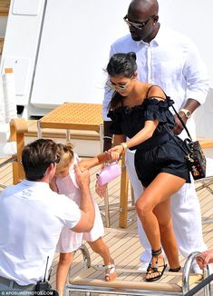 All aboard! Kourtney helped her young daughter as she excitedly clambered on board